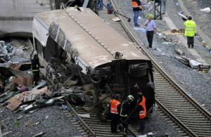 Rescue workers inspect the wreckage of a train crash near Santiago de Compostela